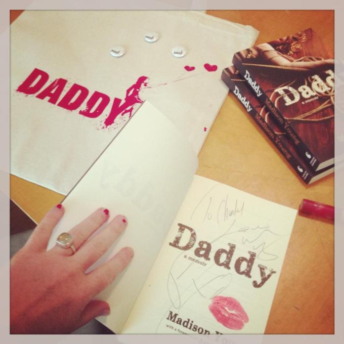 Madison signs copies of Daddy.